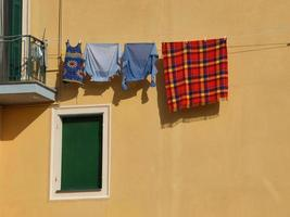 Drying clothes by the window on the city building photo