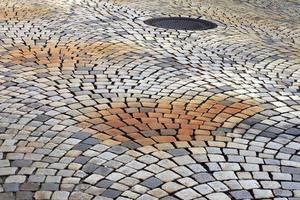 The road surface is made of beautiful patterned stones photo