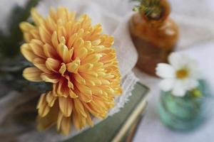 Close-up of yellow flowers and white fabric, vintage style. photo