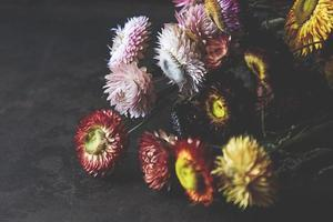 Close-up of beautiful festive bouquets on gray background photo
