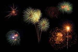 Set of colorful fireworks on black background. photo