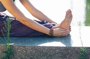 Closeup female hand holding foot stretching pose photo