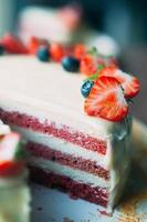 Selective macro focus cake with berries and white glaze photo