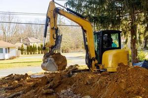 Excavator loader at earth moving works photo
