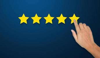 Hand of businessman touching five star symbol photo