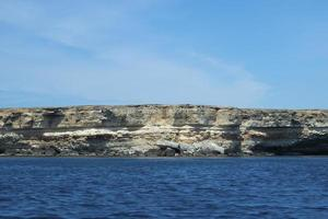 Marine landscape with views of the rocky shore. photo
