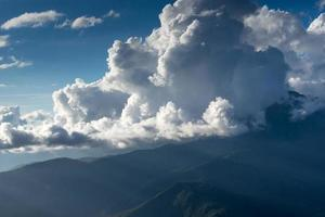 mountain landscape on the background of the cloudy sky and sun rays photo