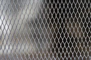 The background of the metal mesh grate photo