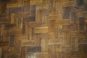 background of old wooden herringbone parquet flooring composed photo