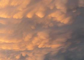Natural sky background with mammatus clouds. photo