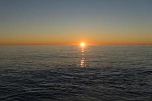 Seascape with a beautiful sunset over the water. photo