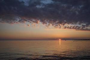 Beautiful dramatic sunset against the sea. photo