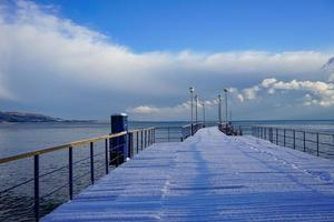 winter landscape with pier in the background of sea and sky. photo