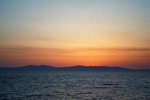 Seascape with sunset over the sea. photo