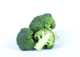 Group of broccoli vegetable on white backgrounds photo
