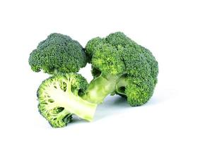 Green broccoli with macro close up on white backgrounds photo