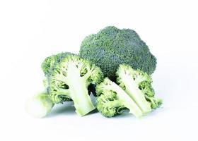 Broccoli vegetable sliced on white backgrounds photo