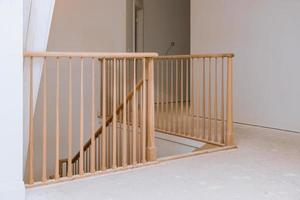 Wooden planks around pole stairs handrails renovation wooden railing photo