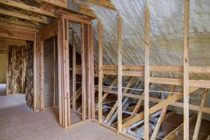 Foam plastic insulation installed in the attic of new frame house. photo