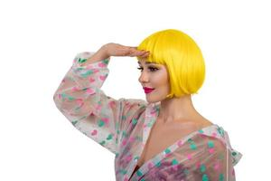 Portrait of woman wearing yellow wig isolated on white background photo