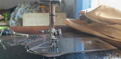 Close up of sewing machine needle photo
