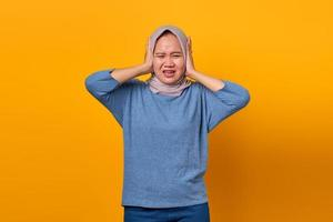 Portrait of attractive Asian woman looking stressed and worried photo