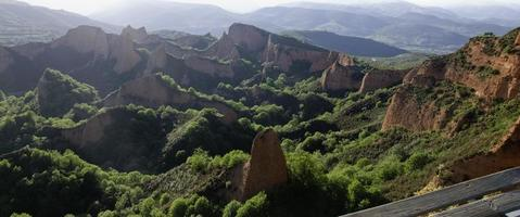 Beautiful landscape with red mountains and green fields. Las Medulas, photo
