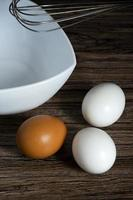 Eggs. Cooking with eggs and whisking photo