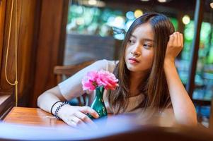 beautiful woman sitting in a chair in a cafe photo