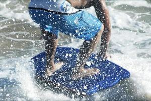 Surf the sea until the water splashes photo
