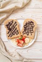 whole wheat bread with fresh banana, strawberry and chocolate photo
