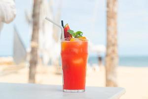 fruit punch with sea beach background photo