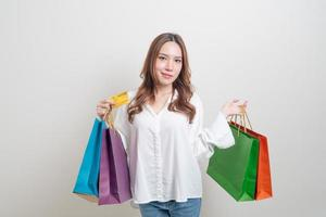 portrait beautiful woman holding shopping bag and credit card photo