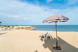 patio outdoor table and chair on beach with sea beach background photo