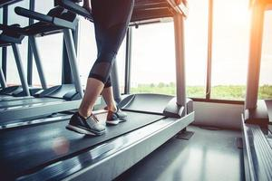 Close up of people who exercising on treadmill photo