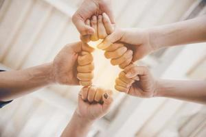 Fist Bump of friendship and teamwork for startup new project photo