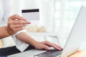 Woman hands holding credit card for online shopping photo