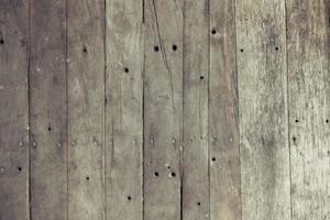 Primer plano de un antiguo fondo de textura de tablón de madera marrón foto