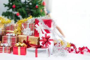 Gift box with Christmas tree background for surprise children photo