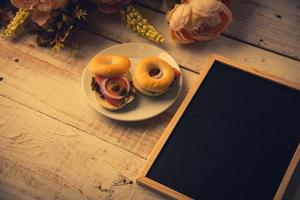 School empty wooden blackboard on wooden floor with hamburger bread photo