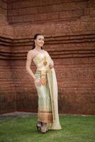 Beautiful Woman wearing typical Thai dress photo