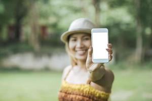 woman hand holding cellphone, smartphone with white screen photo