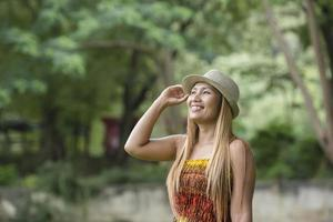 Happy Young Woman Smile And Walking In The Park photo