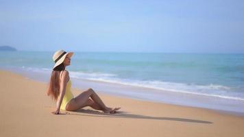 Asian woman enjoys beautiful ocean beach video