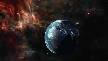 Galaxy Traveling with Earth  planet in space with glow nebula cloud. video