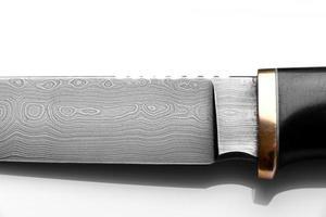 Handmade beautiful hunting knife with a sharp gray blade photo