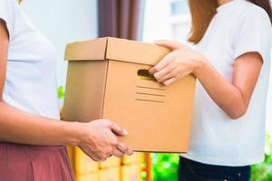 Delivery box of products and women hands when service at home photo