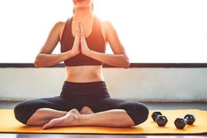 Front view beauty woman doing yoga and raise hand photo