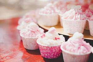 Pink cup cakes in wedding ceremony photo