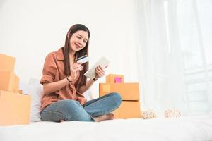 Young Asian woman startup small business entrepreneur photo